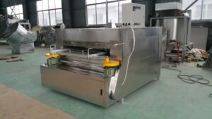 coated nut swing oven